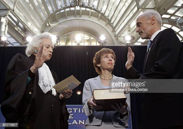 Michael Chertoff is sworn in by Supreme Court Justice Sandra Day O'Connor while his wife Meryl looks on during the swearingin ceremony for the...