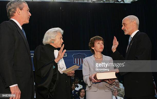 Michael Chertoff right takes the oath of office as Secretary of Homeland Security from Supreme Court Justice Sandra Day O'Connor second from left...