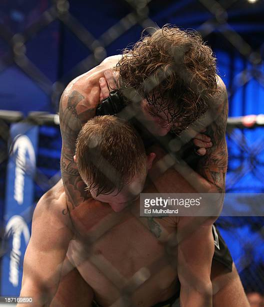 Michael Chiesa attempts to submit Colton Smith in their UFC lightweight bout on November 6 2013 in Fort Campbell Kentucky
