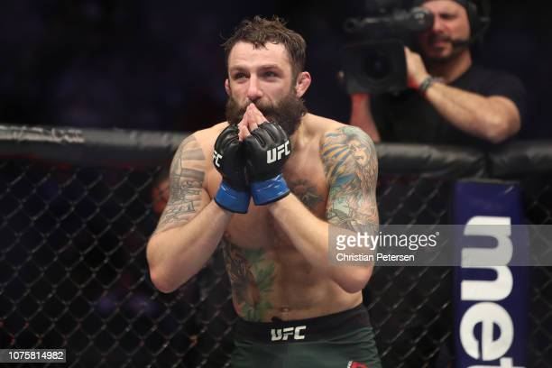 Michael Chiesa celebrates after defeating Carlos Condit in their welterweight bout during the UFC 232 event inside The Forum on December 29 2018 in...