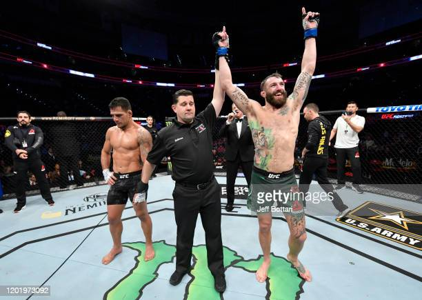 Michael Chiesa celebrates after his decision victory over Rafael Dos Anjos of Brazil in their welterweight fight during the UFC Fight Night event at...