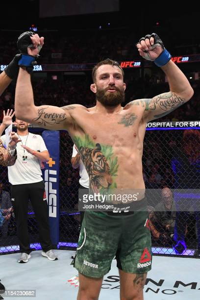Michael Chiesa celebrates his win over Diego Sanchez in their welterweight fight during the UFC 239 event at TMobile Arena on July 6 2019 in Las...