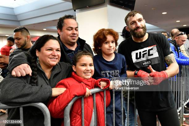 Michael Chiesa interacts with fans after an open training session for fans and media during the UFC Fight Night Open Workouts at PNC Arena on January...