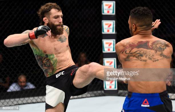 Michael Chiesa kicks Kevin Lee in their lightweight bout during the UFC Fight Night event at the Chesapeake Energy Arena on June 25 2017 in Oklahoma...