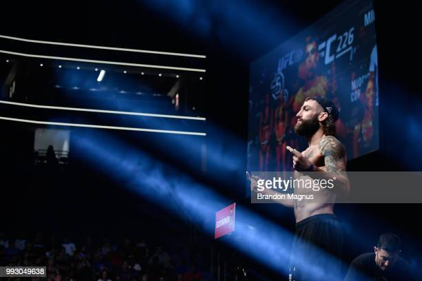 Michael Chiesa poses on the scale during the UFC 226 weighin inside TMobile Arena on July 6 2018 in Las Vegas Nevada