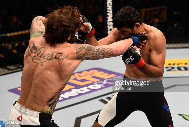 Michael Chiesa punches Beneil Dariush in their lightweight bout during the UFC Fight Night event at Amalie Arena on April 16, 2016 in Tampa, Florida.