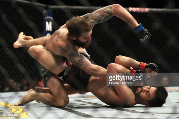 Michael Chiesa punches Carlos Condit in their welterweight bout during the UFC 232 event inside The Forum on December 29, 2018 in Inglewood,...