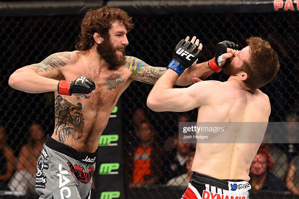 Michael Chiesa punches Mitch Clarke in the face in their lightweight fight during the UFC Fight Night event at the Patriot Center on April 4, 2015 in Fairfax, Virginia.