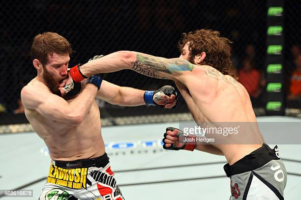 Michael Chiesa punches Mitch Clarke in their lightweight fight during the UFC Fight Night event at the Patriot Center on April 4 2015 in Fairfax...