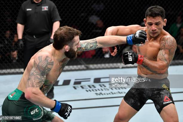 Michael Chiesa punches Rafael Dos Anjos of Brazil in their welterweight fight during the UFC Fight Night event at PNC Arena on January 25 2020 in...
