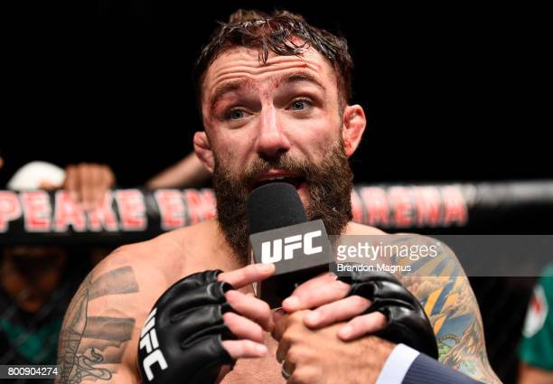 Michael Chiesa reacts after his submission loss to Kevin Lee in their lightweight bout during the UFC Fight Night event at the Chesapeake Energy...