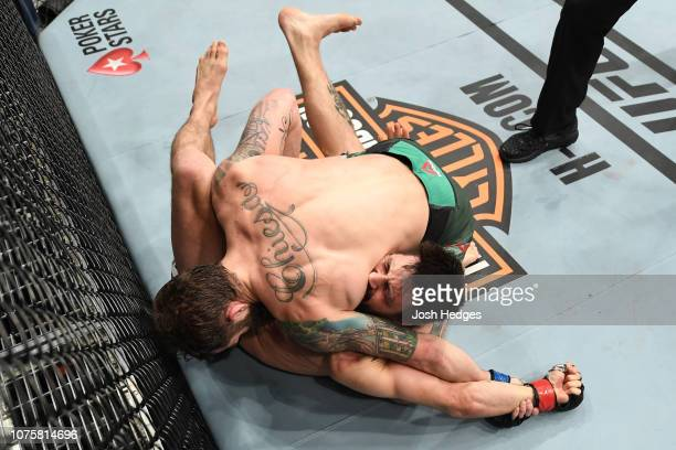 Michael Chiesa submits Carlos Condit in their welterweight bout during the UFC 232 event inside The Forum on December 29, 2018 in Inglewood,...