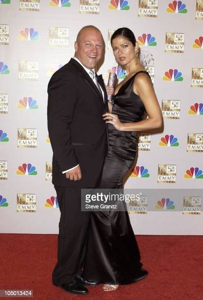 Michael Chiklis winner of Best Lead Actor In A Drama Series 'The Shield' and Jill Hennessy at the 54th Annual Emmy Awards