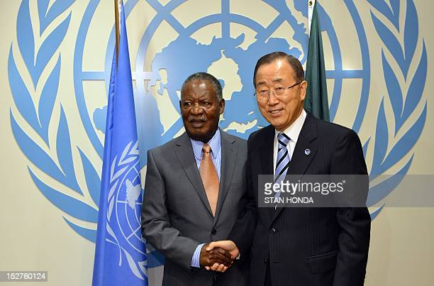 Michael Chilufya Sata President of Zambia shakes hands with United Nations Secretary General Ban KiMoon before their meeting September 25 2012 during...