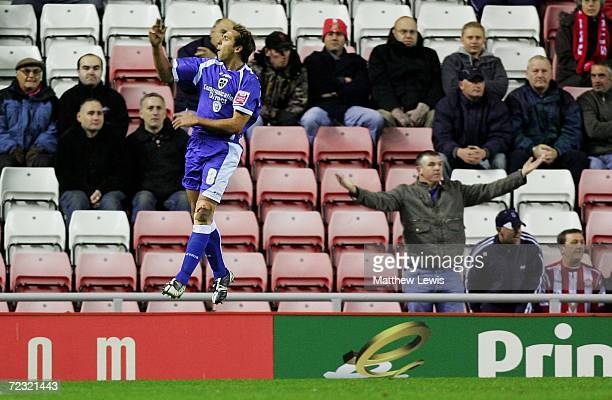 Michael Chopra of Cardiff celebrates his second goal as a Sunderland fan looks on during the CocaCola Championship match between Sunderland and...