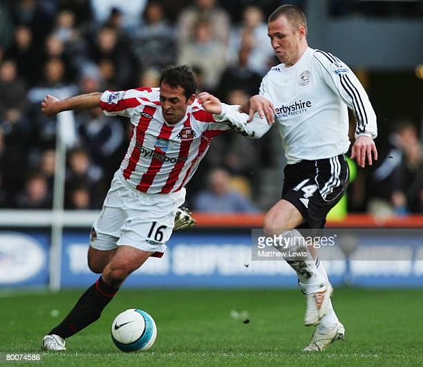 Michael Chopra of Sunderland and Kenny Miller of Derby County challenge for the ball during the Barclays Premier League match between Derby and...