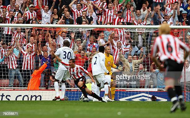 Michael Chopra of Sunderland celebrates his last minute winning goal as Spurs keeper Paul Robinson looks on, during the Barclays Premier League match...