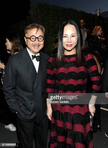 Michael Chow and Eva Chow at the MOCA Gala 2017 honoring Jeff Koons at The Geffen Contemporary at MOCA on April 29 2017 in Los Angeles California