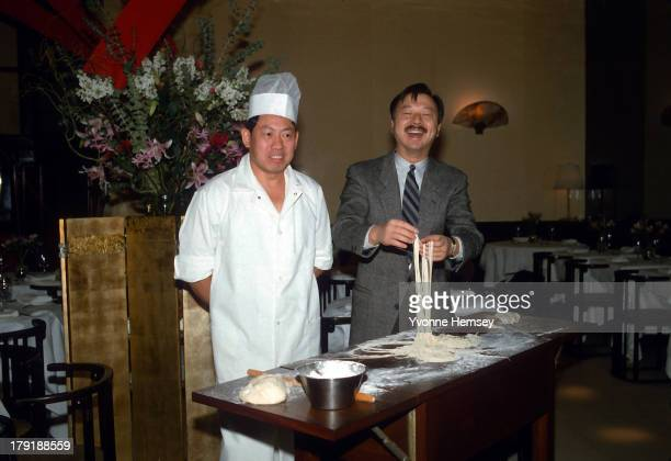 Michael Chow cofounder and owner of the Mr Chow restaurant chain is photographed along with his chef on December 8 1983 at his restaurant in New York...