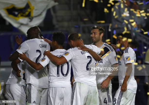 Michael Ciani Giovani dos Santos Perry Kitchen Dave Romney and Jonathan dos Santos of Los Angeles Galaxy celebrate with teammate Romain Alessandrini...