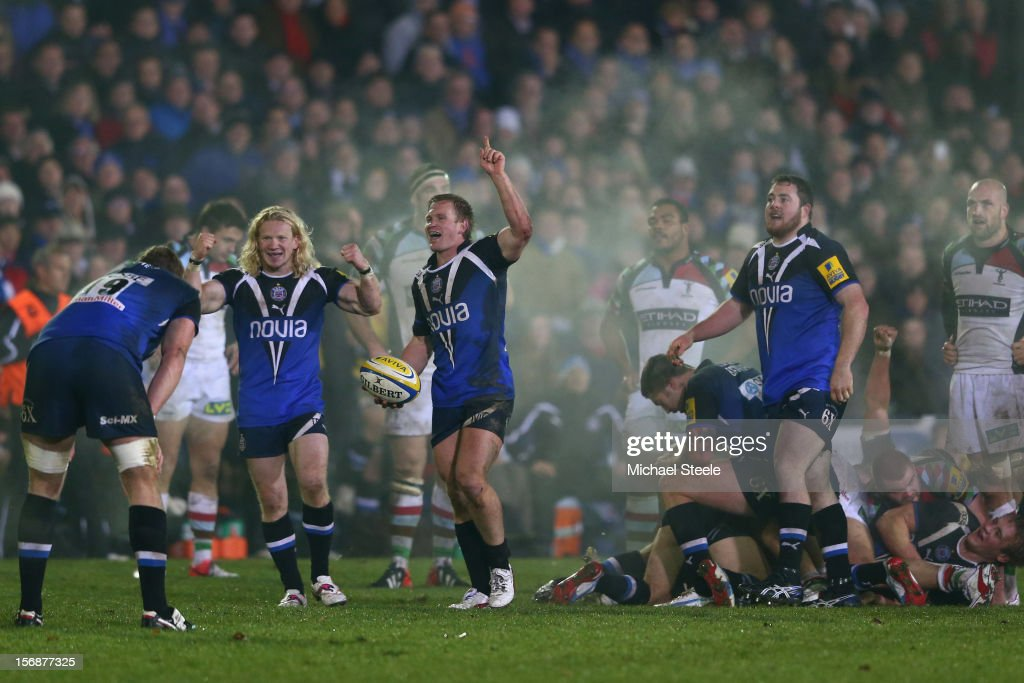 Michael Claassens (C) and Tom Biggs (2L) of Bath celebrate their sides 21-18 victory on the final whistle during the Aviva Premiership match between Bath and Harlequins at the Recreation Ground on November 23, 2012 in Bath, England.