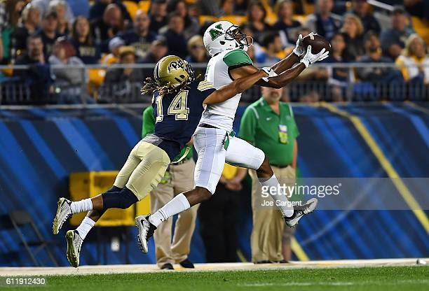 Michael Clark of the Marshall Thundering Herd makes a catch in front of the defense of Avonte Maddox of the Pittsburgh Panthers during the first...