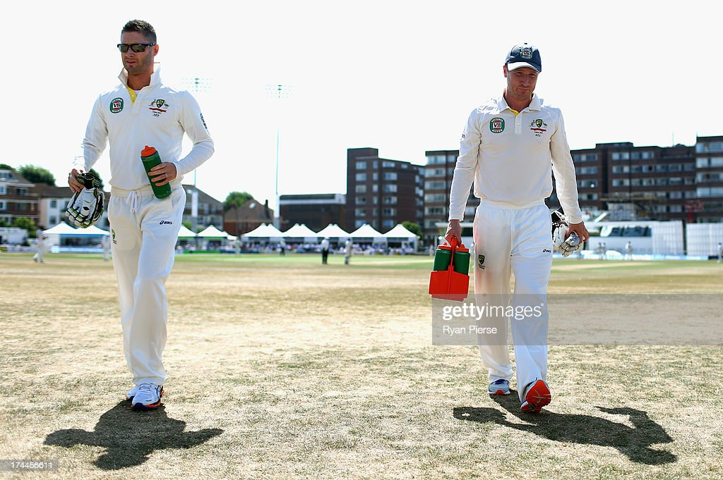 Michael Clarke and Brad Haddin of Australia carry the drinks during Day One of the Tour Match between Sussex and Australia at The County Ground on July 26, 2013 in Hove, England.