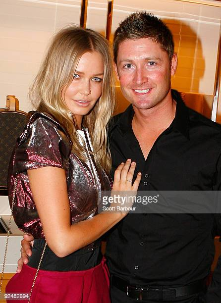 Michael Clarke and Lara Bingle pose for a photograph as they arrive for the first anniversary of the Louis Vuitton Collins Street store on October 29...