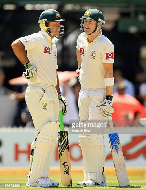 Michael Clarke and Ricky Ponting of Australia talk between overs during their 386 run partnership during day two of the Fourth Test Match between...