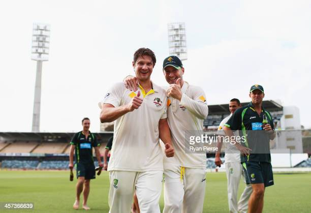 Michael Clarke and Shane Watson of Australia celebrate on the pitch after day five of the Third Ashes Test Match between Australia and England at...