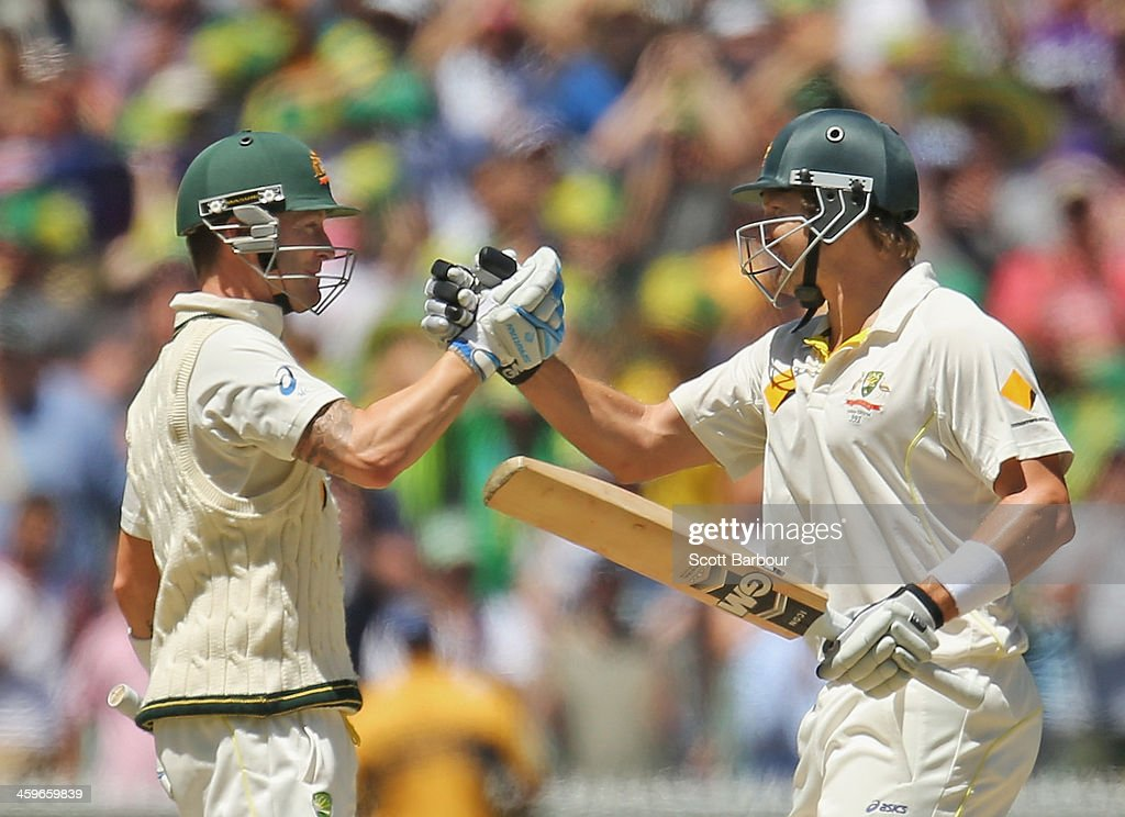 Michael Clarke (L) and Shane Watson of Australia embrace as Australia win the match during day four of the Fourth Ashes Test Match between Australia and England at Melbourne Cricket Ground on December 29, 2013 in Melbourne, Australia.