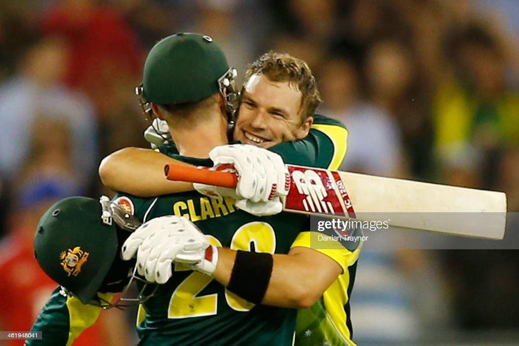 Michael Clarke congratulates Aaron Finch of Australia after he scored 100 runs during game one of the one day international series between Australia and England at Melbourne Cricket Ground on January 12, 2014 in Melbourne, Australia.