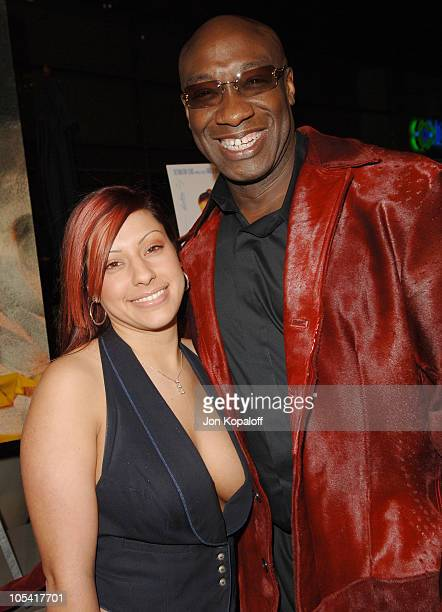 Michael Clarke Duncan and girlfriend Irene during DEBS Los Angeles Premiere Arrivals at ArcLight Hollywood Theatre in Hollywood California United...