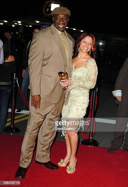 Michael Clarke Duncan and Irene Marquez during Sin City Los Angeles Premiere Arrivals at Mann National Premiere in Westwood California United States