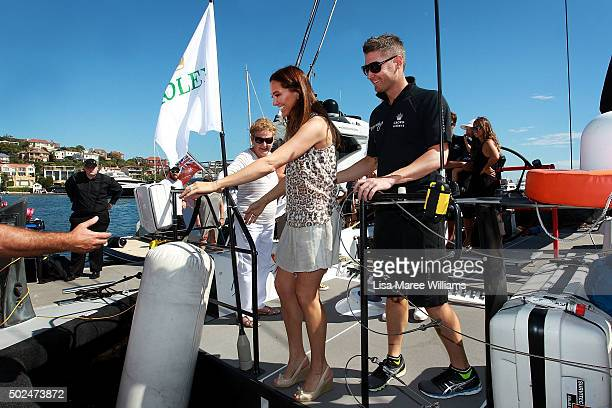 Michael Clarke helps wife Kyly Clarke step off Perpetual LOYAL during the Boxing Day Bon Voyage at Rose Bay Marina on December 26 2015 in Sydney...