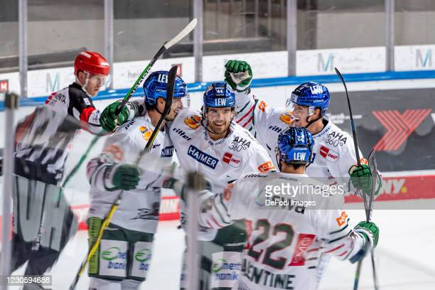 Michael Clarke of Augsburger Panther celebrates after scoring his team's 0:1 goal during the DEL match between EHC Red Bull Muenchen and Augsburger...