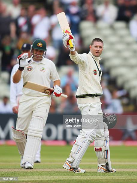 Michael Clarke of Australia acknowledges his century with Graham Manou during day five of the npower 3rd Ashes Test Match between England and...