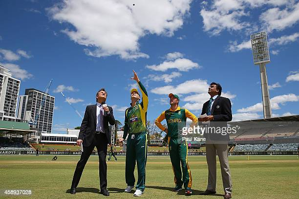 Michael Clarke of Australia and AB de Villiers of South Africa attend the coin toss before game one of the men's one day international series between...