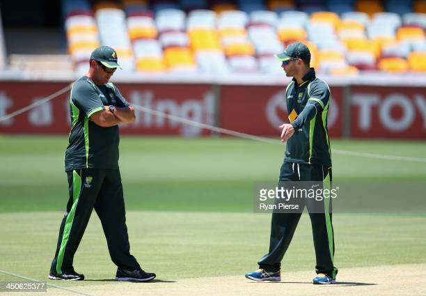 Michael Clarke of Australia and Former Captain Mark Taylor inspect the pitch during an Australian Nets Session at The Gabba on November 20 2013 in...