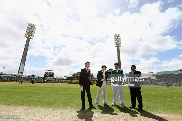 Michael Clarke of Australia and Graeme Smith of South Africa are seen on the pitch for the coin toss during day one of the Third Test Match between...