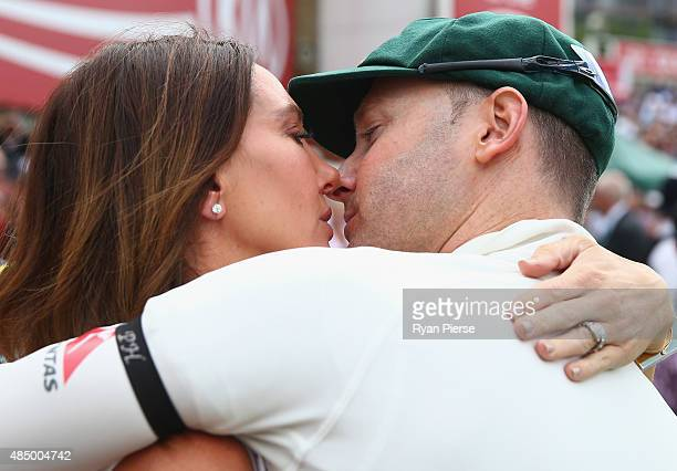 Michael Clarke of Australia and his wife Kyly Clarke kiss after his last test match during day four of the 5th Investec Ashes Test match between...