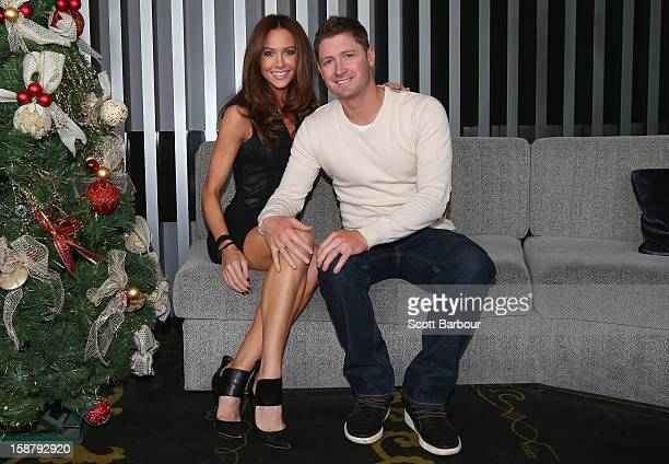 Michael Clarke of Australia and his wife Kyly Clarke pose ahead of a Cricket Australia Christmas Day lunch at Crown Entertainment Complex on December...