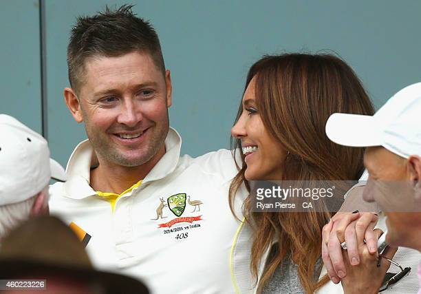 Michael Clarke of Australia and his wife Kyly Clarke speak during a rain delay during day two of the First Test match between Australia and India at...