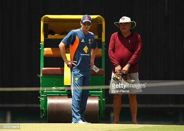 Michael Clarke of Australia and Kevin Mitchell curator of the Gabba inspect the pitch during an Australian nets session at The Gabba on November 23...