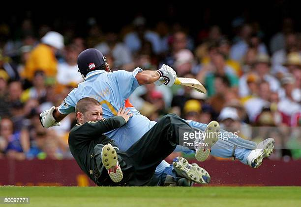 Michael Clarke of Australia and Sachin Tendulkar of India collide as Clarke attempts to field the ball during the Commonwealth Bank Series One Day...