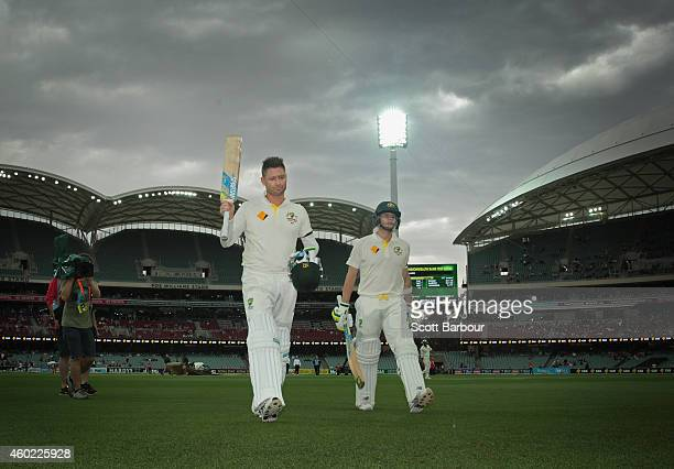 Michael Clarke of Australia and Steven Smith leave the field for a rain delay after Clarke reached his century during day two of the First Test match...