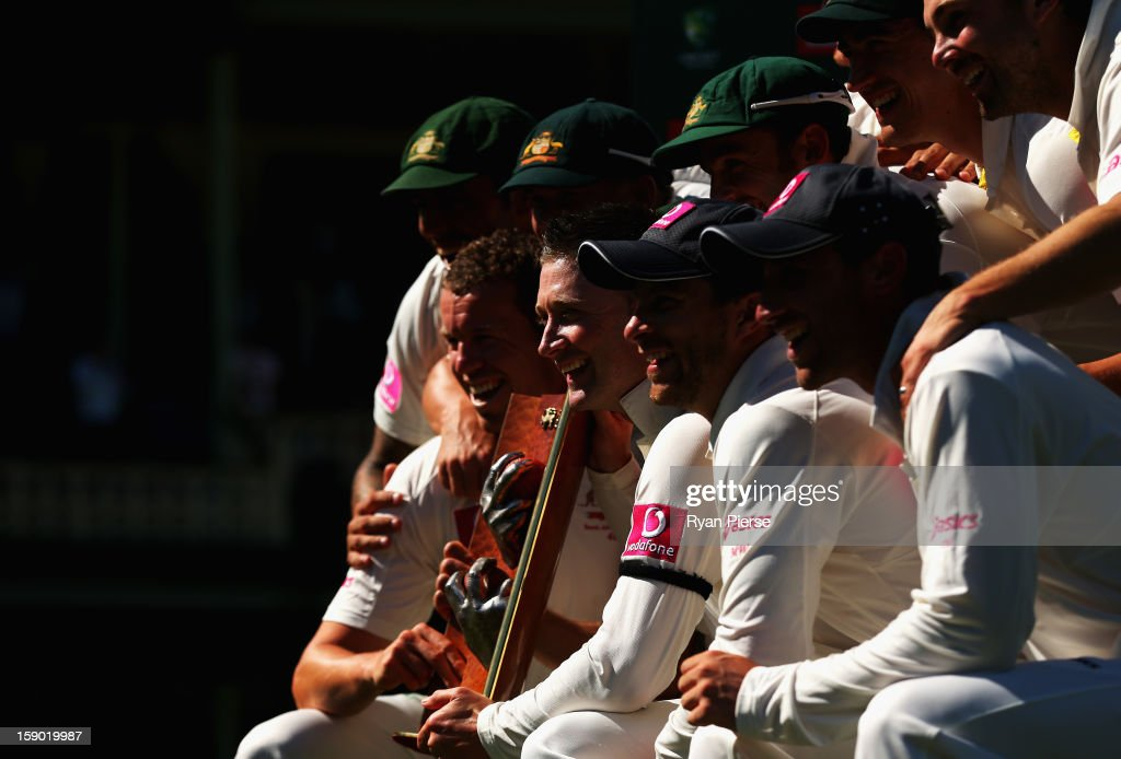 Michael Clarke of Australia and the Australian team celebrate with the trophy after claiming victory during day four of the Third Test match between Australia and Sri Lanka at Sydney Cricket Ground on January 6, 2013 in Sydney, Australia.