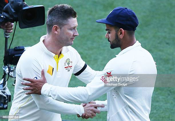 Michael Clarke of Australia and Virat Kohli of India shake hands after day five of the First Test match between Australia and India at Adelaide Oval...