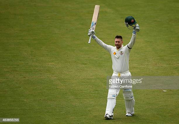 Michael Clarke of Australia celebrates after he scored his century during day two of the Second Ashes Test Match between Australia and England at...