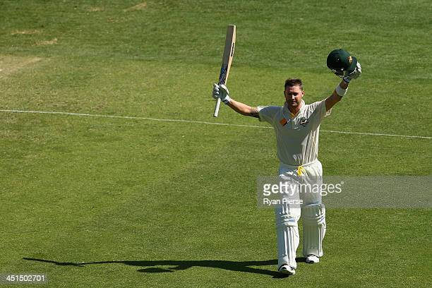 Michael Clarke of Australia celebrates after reaching his century during day three of the First Ashes Test match between Australia and England at The...